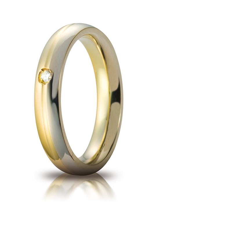 Fedi nunziali unoaerre Cerchi di Luce arricchite da sigillo UNOAERRE in oro giallo.